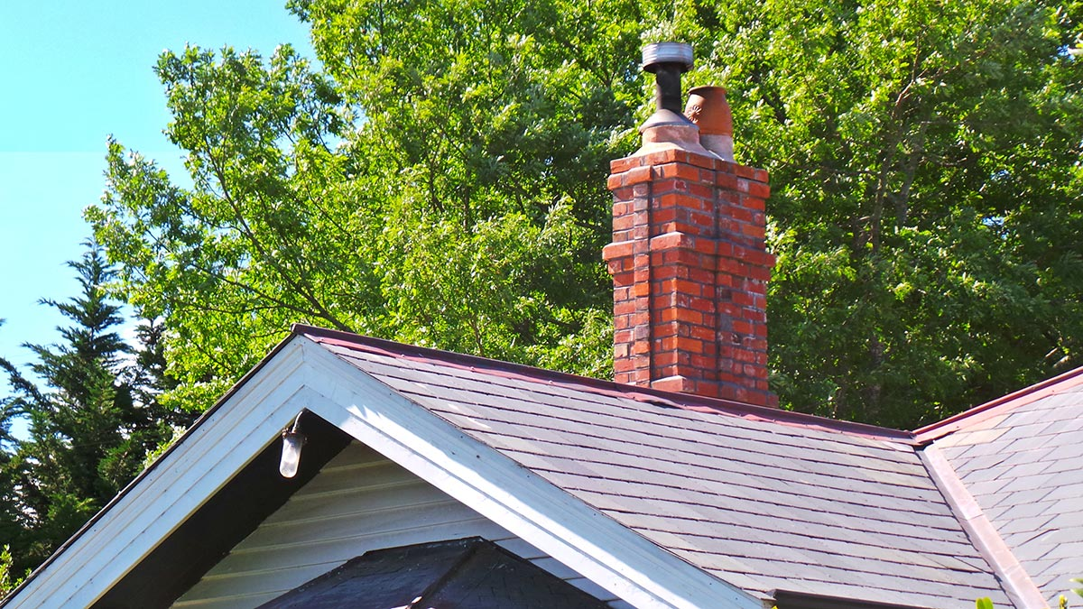 Composite and brick slip replica chimney repaired after earthquakes