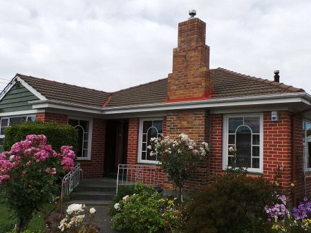 Large wedding-cake chimney, Quakesafe and Quake Proof on brick and tile home in Christchurch