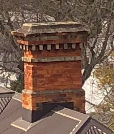 Old Auckland masonry chimney with degraded lime mortar, rotten chimney