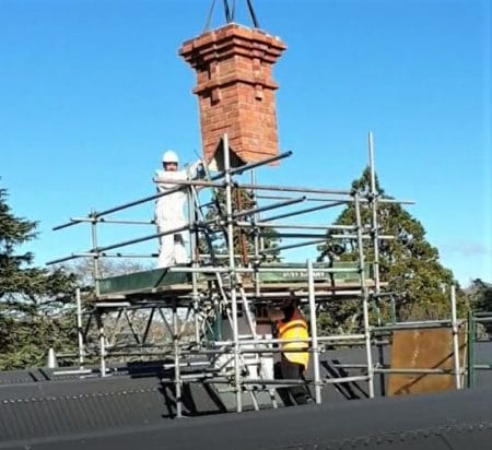 Install of Red Mantle replica chimney to support frame
