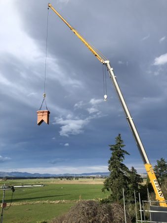 Lightweight Red Mantle Chimney craned into place over support frame