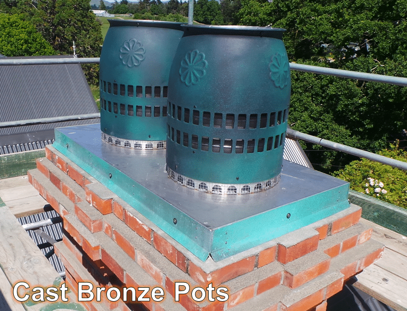 Cast bronze chimney pots on top of a heritage replica chimney now Quake Proof by Red Mantle