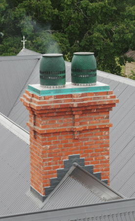 Replacement brick slip replica chimney on large Canterbury Home. Leslie Hills Homestead restored after earthquakes. Building is now Quake Safe and Quake Proof Chimeys
