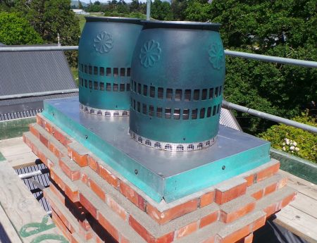 Red Mantle Cast Bronze pots on top of Quakesafe and Quake Proof Chimneys in Canterbury