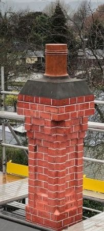 Restored heritage chimney using original bricks over fibreglass and tuck pointed. Red Mantle Chimney, QPC