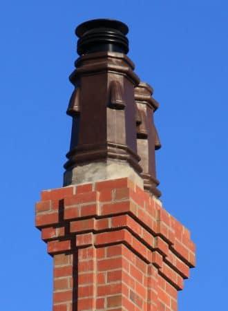 Moulded composite chimney pots on earthquake restoration of Te Koraha HouseHouse